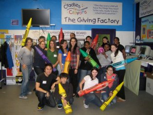 2010 - Scholars give back by volunteering at Cradles to Crayons