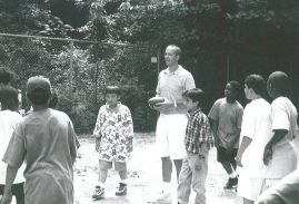 1995 - Between classes, Mike plays football with Scholars